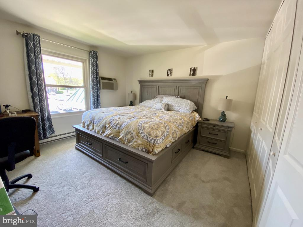 Sunny, spacious main bedroom - 3429 S LEISURE WORLD BLVD #88-3E, SILVER SPRING