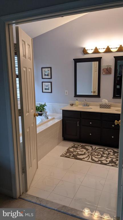 Partial View of Primary Bath from bedroom - 10481 COURTNEY DR, FAIRFAX