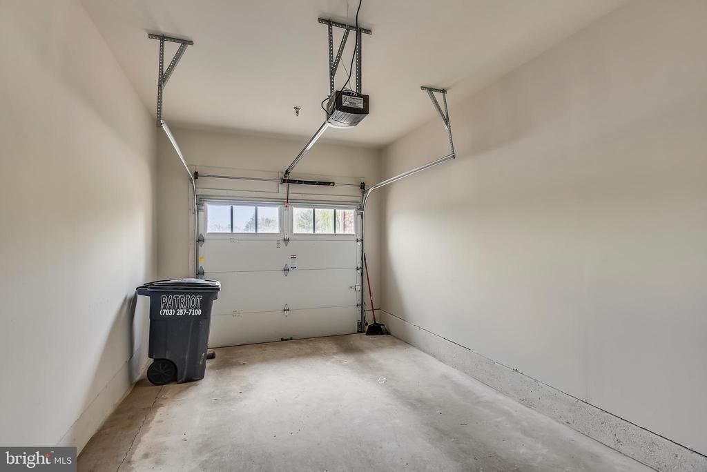 Garage opens to a long driveway. - 43371 LOCUST DALE TER #117, ASHBURN