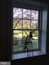 View out window on the stairwell to front area - 21943 ST LOUIS RD, MIDDLEBURG