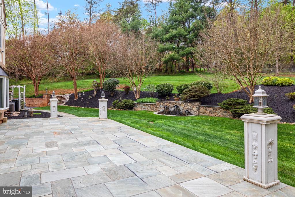 Large slate patio with custom columns & lighting - 2405 OAKMONT CT, OAKTON