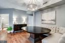 Dining Area with Long Table and Banquette Seating - 11990 MARKET ST #411, RESTON