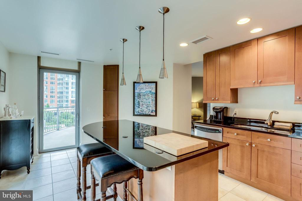 Kitchen has entry to Rounded/Covered Balcony - 11990 MARKET ST #411, RESTON