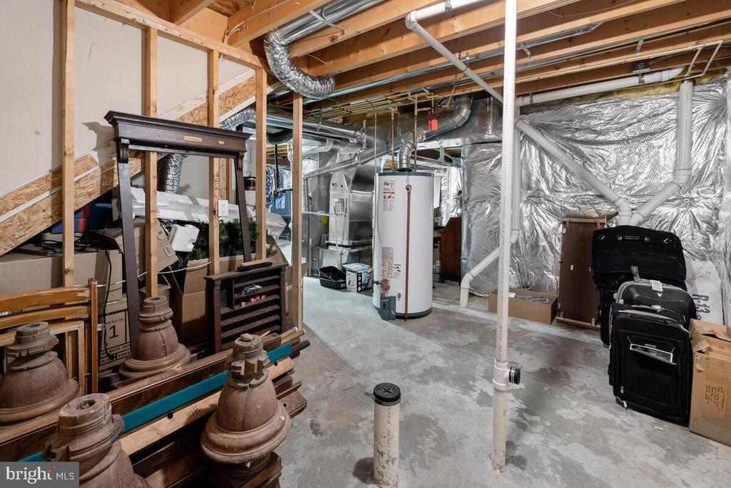 Unfinished portion of basement with bath roughin - 2104 BEAR CREEK CT, FREDERICK