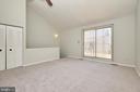 Loft style primary bedroom with vaulted ceilings - 104-B N BEDFORD ST, ARLINGTON