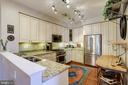 Updated kitchen with custom cabinetry. - 1206 WOODBROOK CT, RESTON