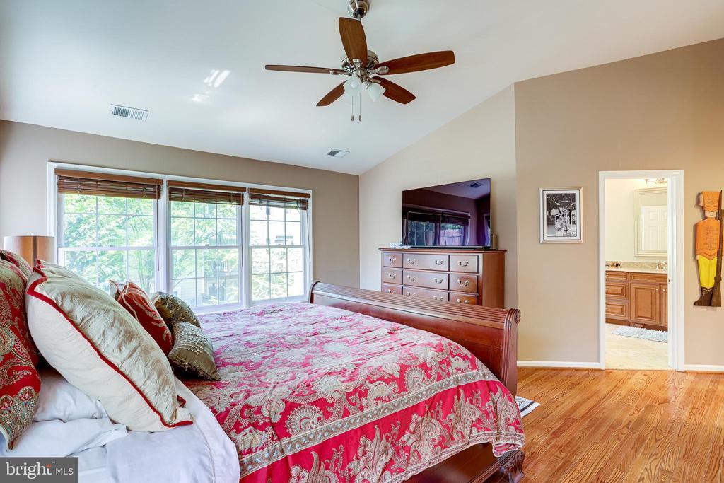 Large walk-in closet w/custom shelving in bedroom. - 1206 WOODBROOK CT, RESTON