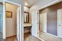 Owners en-suite bath with separate vanities - 23397 MORNING WALK DR, BRAMBLETON