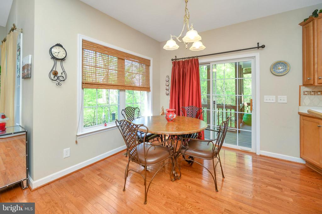Breakfast room with access to screened porch - 609 STRATFORD CIR, LOCUST GROVE