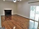 FR: Lighted ceiling fan, hardwoods, crown moulding - 12520 BROWNS FERRY RD, HERNDON