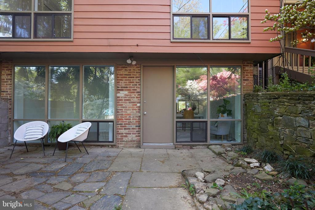 Lower level entrance with stone patio - 11530 HIGHVIEW AVE, SILVER SPRING
