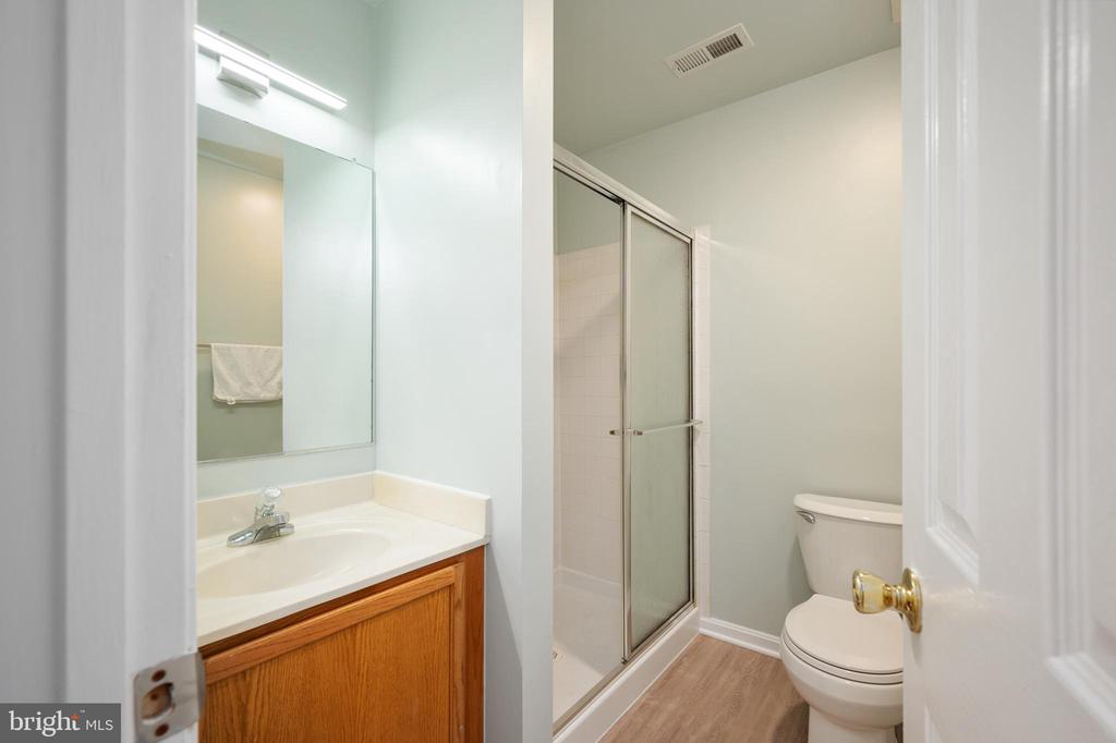 New LVP floors & lighting lower level bath. - 4 CATHERINE LN, STAFFORD
