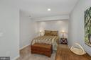 Lower Level Flex room used here as a guest bedroom - 122 BALCH SPRINGS CIR SE, LEESBURG