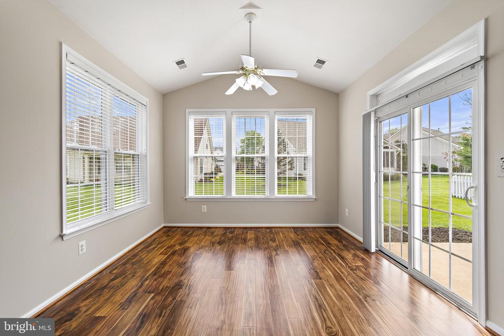 Bright and airy Sun room that leads to patio - 6293 CULVERHOUSE CT, GAINESVILLE