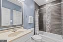 Lower level bathroom. - 304 BERRY ST SE, VIENNA