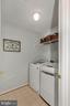 Upper Floor Laundry Room with tile floor - 122 BALCH SPRINGS CIR SE, LEESBURG