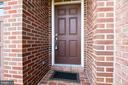 Covered porch leading into your main level - 115 GRACIE PARK DR, HERNDON