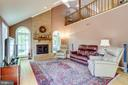 Sun filled family room with wood burning fireplace - 19 GRISWOLD CT, POTOMAC FALLS