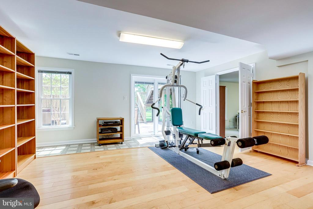 Exercise area with access to patio and hot tub - 19 GRISWOLD CT, POTOMAC FALLS