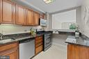 Kitchen with Marble Countertops and Floors - 1200 N NASH ST #240, ARLINGTON