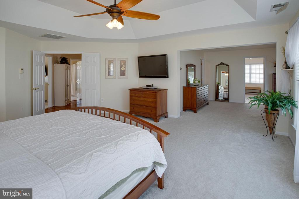 Check out the coffered ceiling and open concept - 42624 LEGACY PARK DR, BRAMBLETON