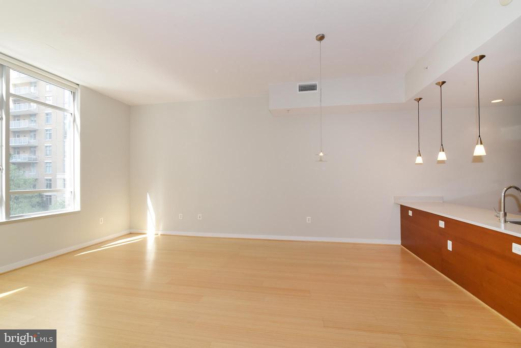 Beautiful sun-filled living room and dining room - 12025 NEW DOMINION PKWY #311, RESTON