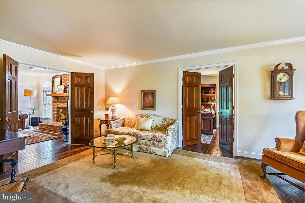 Living room view into library and fam. room - 11949 GREY SQUIRREL LN, RESTON