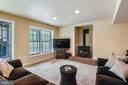 Walkout rec room with Iron stove - 11949 GREY SQUIRREL LN, RESTON