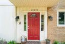 Red door with flowers around - 39895 THOMAS MILL RD, LEESBURG