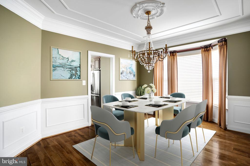 Dining room with mill work: virtually staged (VS) - 43768 RIVERPOINT DR, LEESBURG