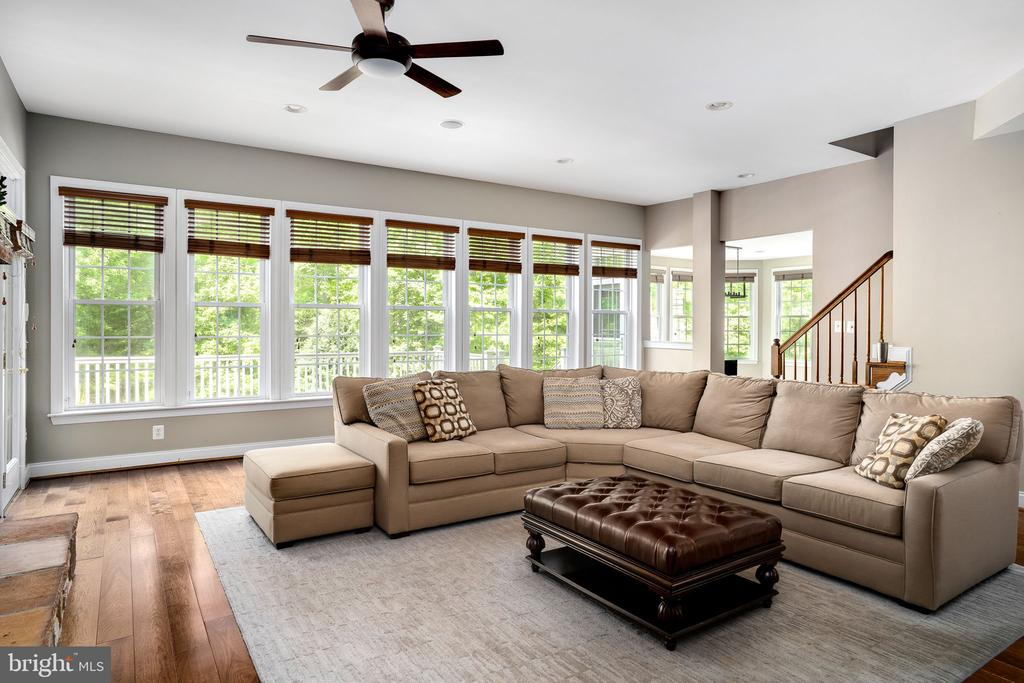 Wall of windows with beautiful tree views - 43768 RIVERPOINT DR, LEESBURG