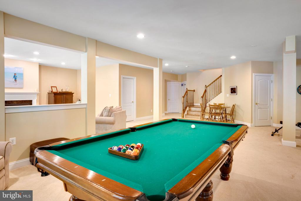 Gorgeous pool table conveys with the home - 43768 RIVERPOINT DR, LEESBURG
