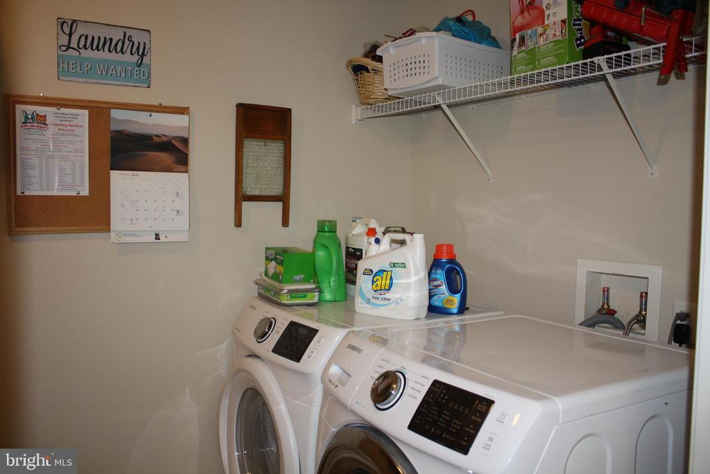 Shelves and washer/dryer hook-up in laundry room - 301 BURR DR, RUTHER GLEN