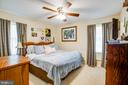 Spacious primary bedroom faces private backyard - 301 BURR DR, RUTHER GLEN