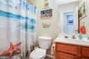 Hallway bathroom has convenient tub/shower combo - 301 BURR DR, RUTHER GLEN