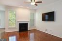 Family room with gas fireplace & wall mounted TV - 42740 OGILVIE SQ, ASHBURN