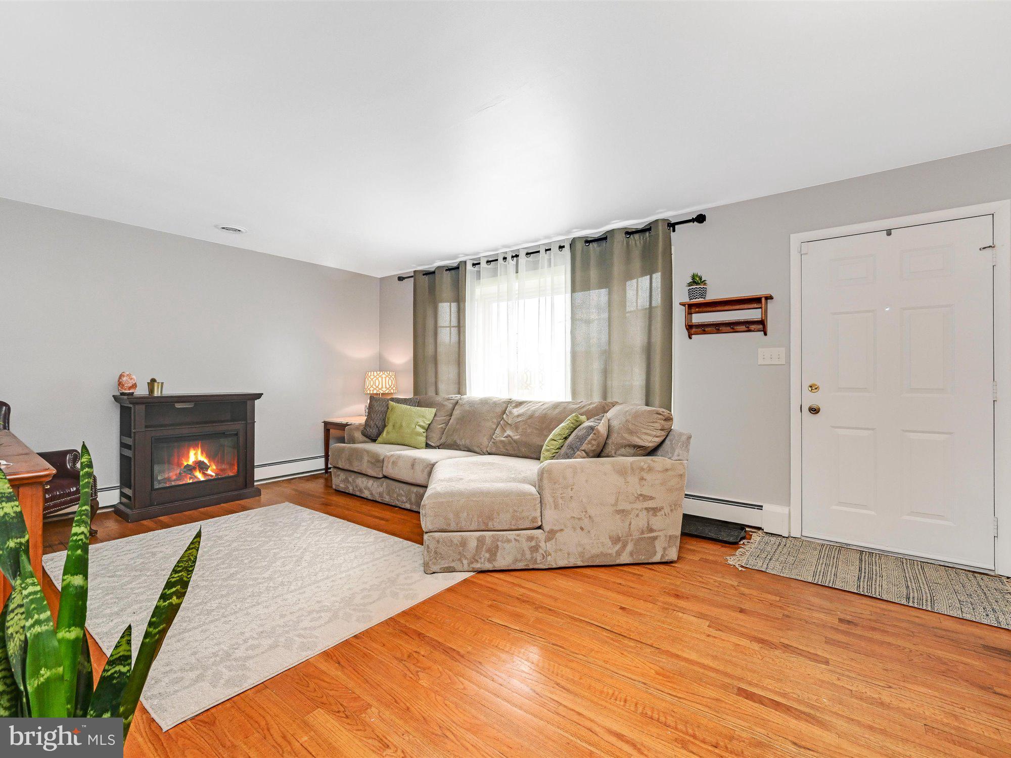 Living room w/big bright window.