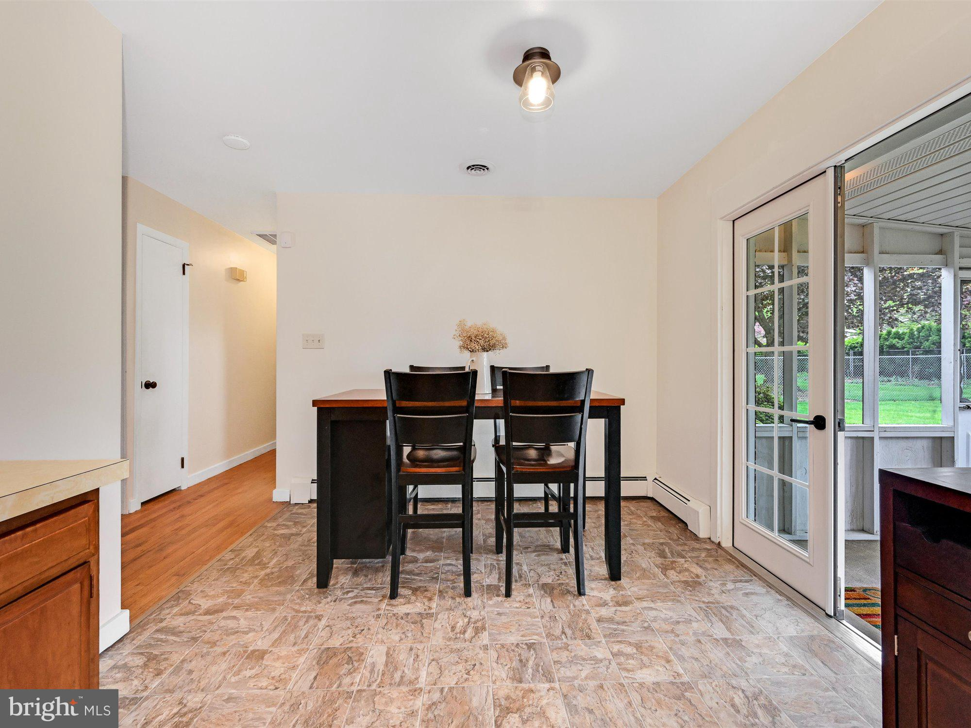 Dining area with French doors to porch.