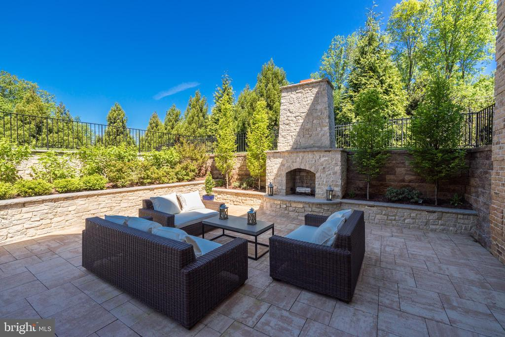 Lower Patio -Stone Retaining Walls and Fireplace - 957 MACKALL FARMS LN, MCLEAN