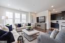 Living room from dining room angle - 11200 RESTON STATION BLVD #301, RESTON