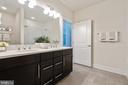 Primary bathroom with double sinks - 11200 RESTON STATION BLVD #301, RESTON