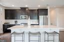 View of kitchen from the living room area - 11200 RESTON STATION BLVD #301, RESTON