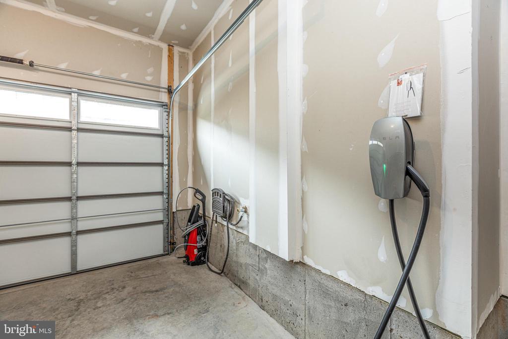 Tesla charger in garage conveys! - 42280 IMPERVIOUS TER, BRAMBLETON