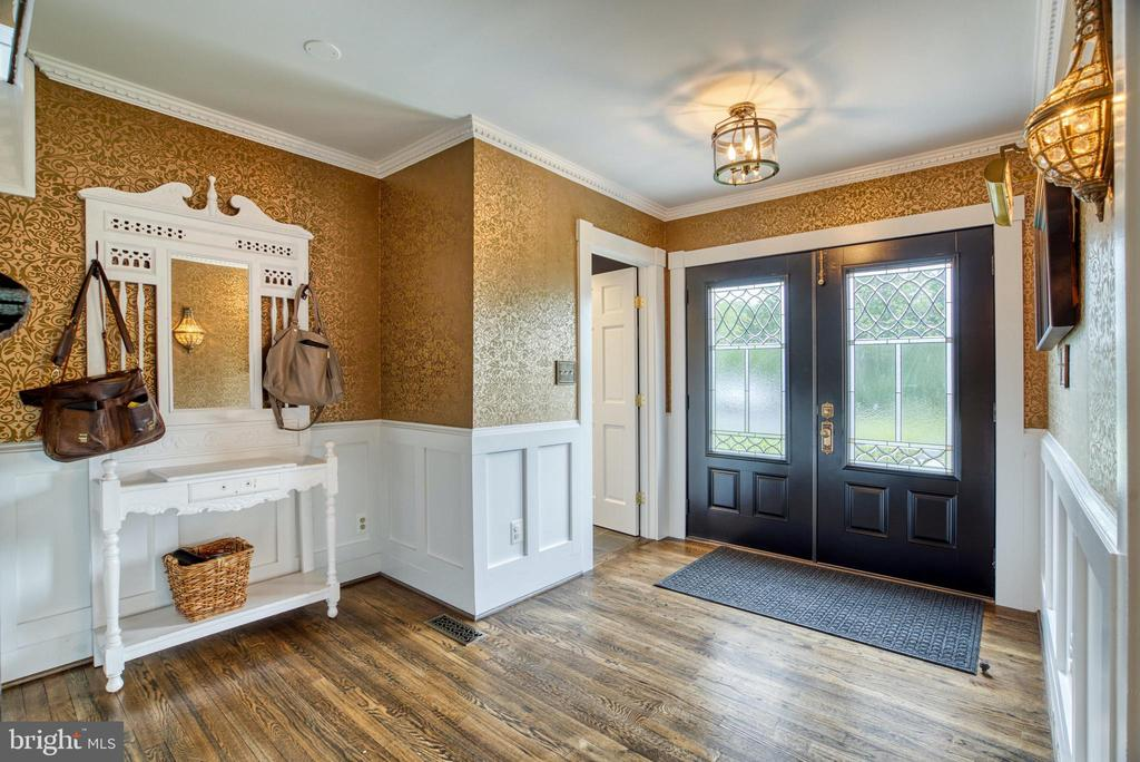 Spacious foyer w/ double entry doors & wainscoting - 7500 CLIFTON RD, CLIFTON