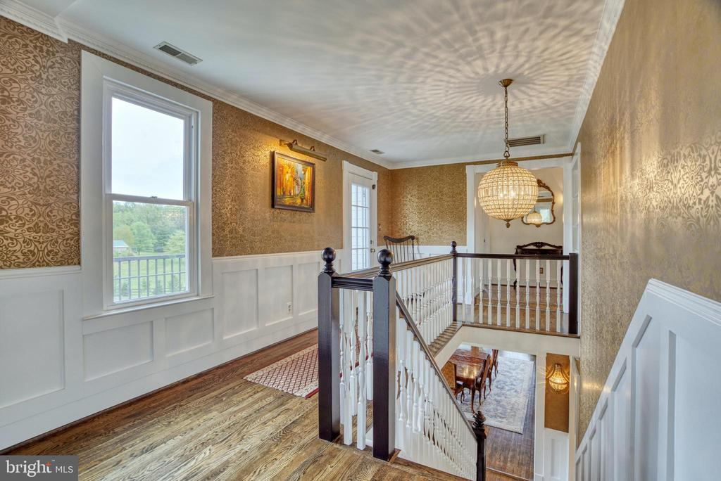 Upper landing. Double staircases. - 7500 CLIFTON RD, CLIFTON