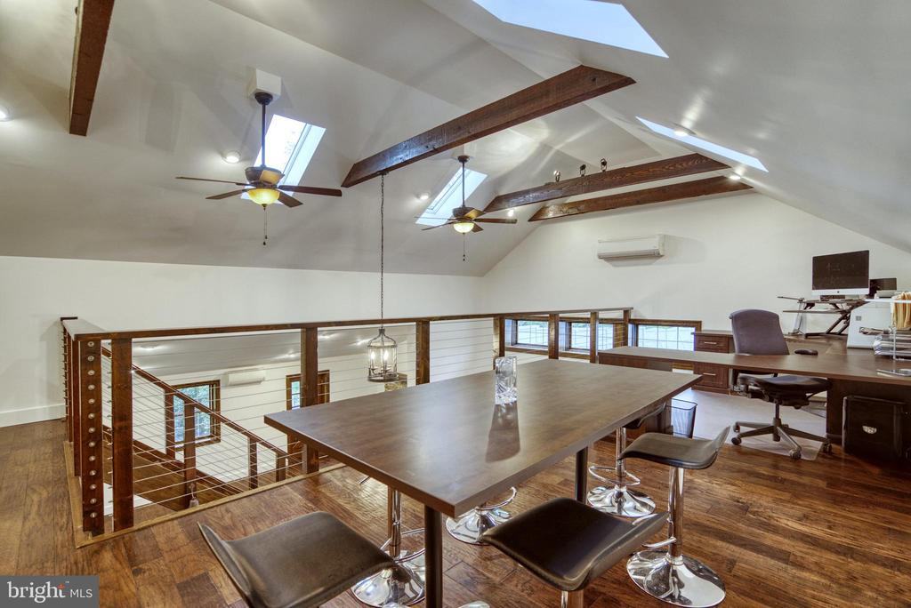 Office Conference area with sky lights. - 7500 CLIFTON RD, CLIFTON