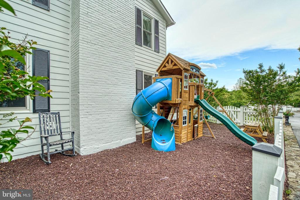 Fenced playground with rubberized flooring. - 7500 CLIFTON RD, CLIFTON
