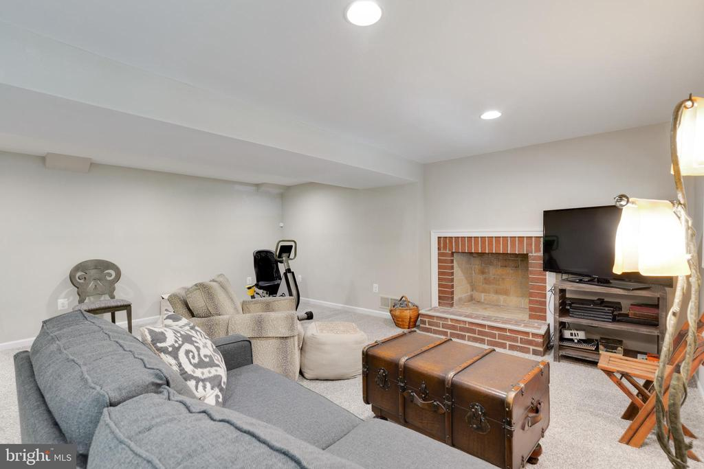 Lower Level Rec Room with Wood Fireplace - 5068 COLERIDGE DR, FAIRFAX