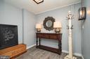 Guest apartment foyer. LVT flooring. - 7500 CLIFTON RD, CLIFTON