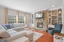 Family room with stone-faced gas fireplace... - 41959 ZIRCON DR, ALDIE